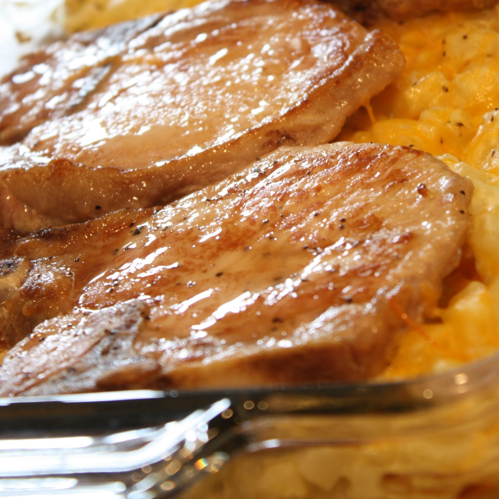 pork chops and potatoes in a baking dish