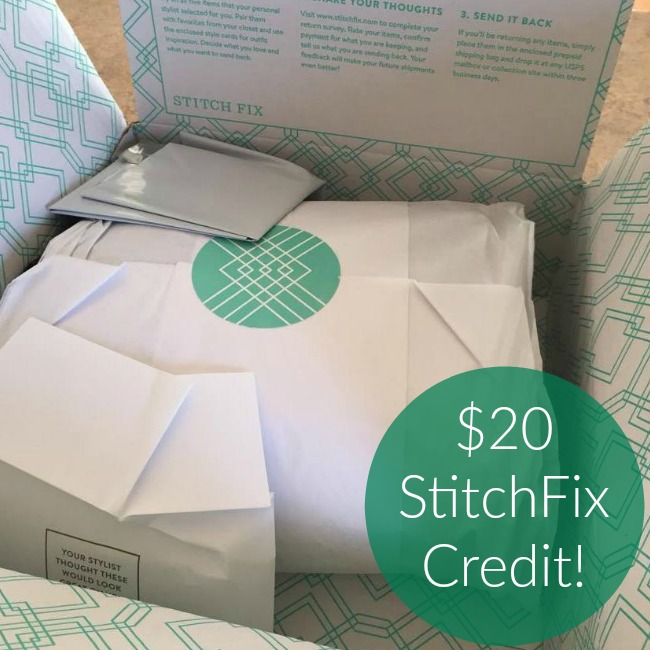 box of free clothes from StitchFix wrapped in white tissue paper