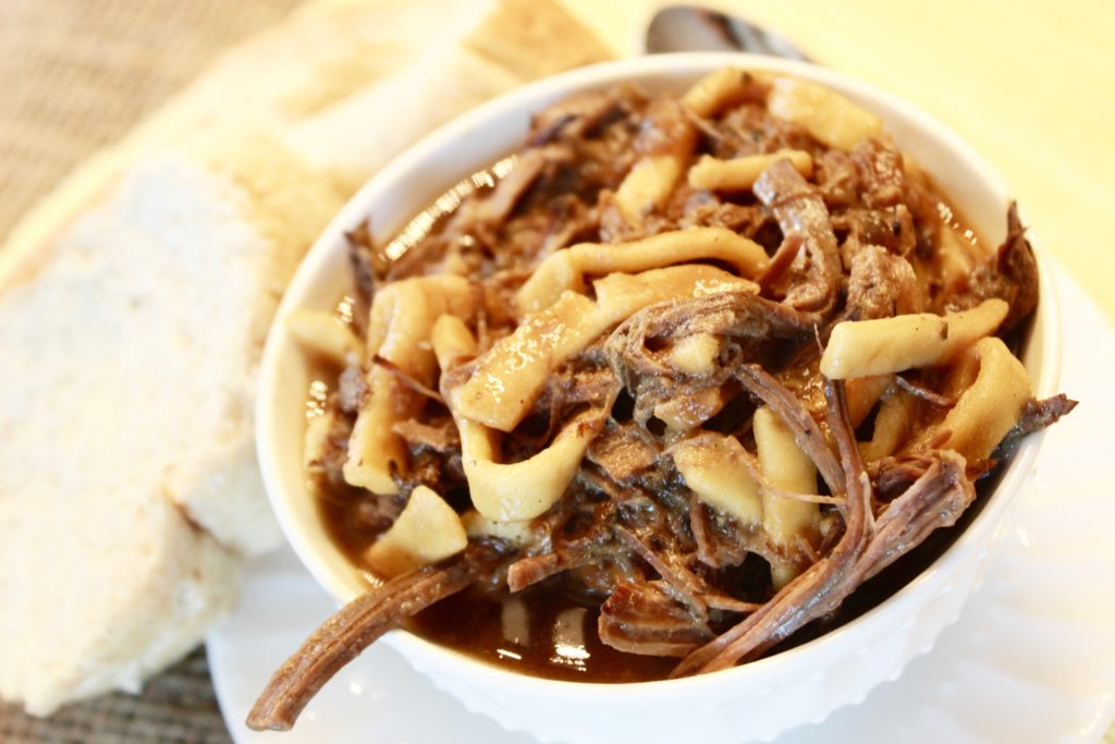 My beef and noodles crock pot recipe in the bowl with bread - YUM!