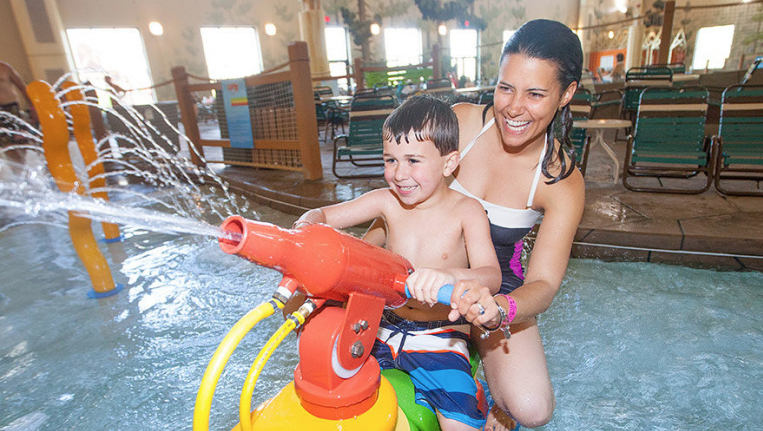 Mom and son playing at Great Wolf Lodge Hotels