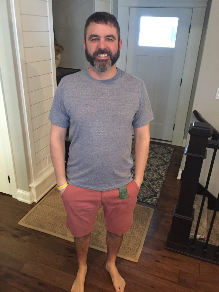 My husband trying his Stitch Fix Mens box clothes on. He liked this heather blue shirt, but it went back.