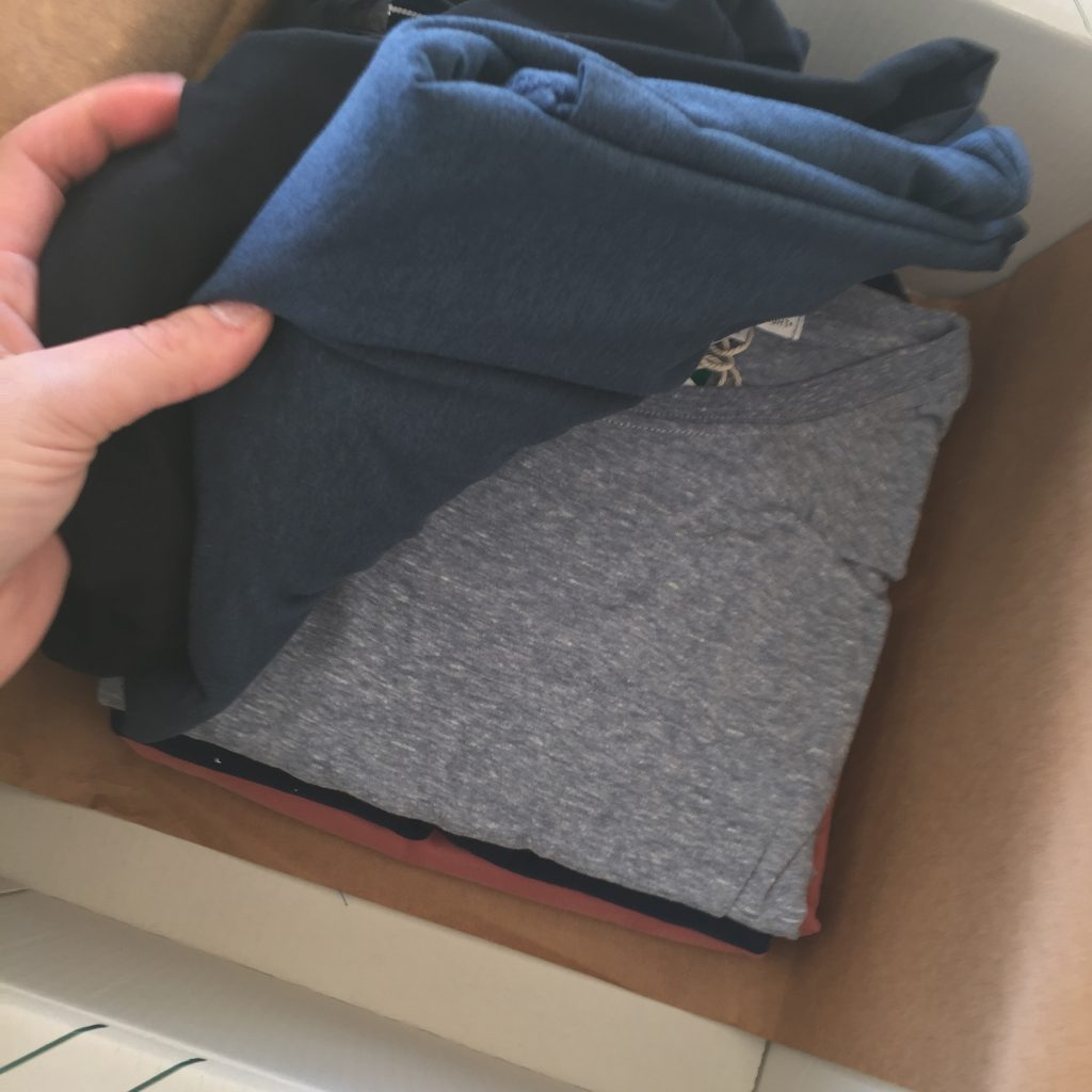 My husband's Stitch Fix box with five Men's casual fix clothing pieces