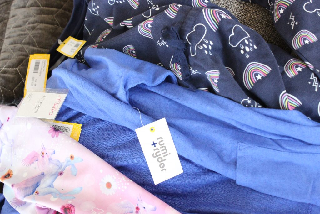 Clothes in the Stitch Fix for kids box. Blue and pink main colors.