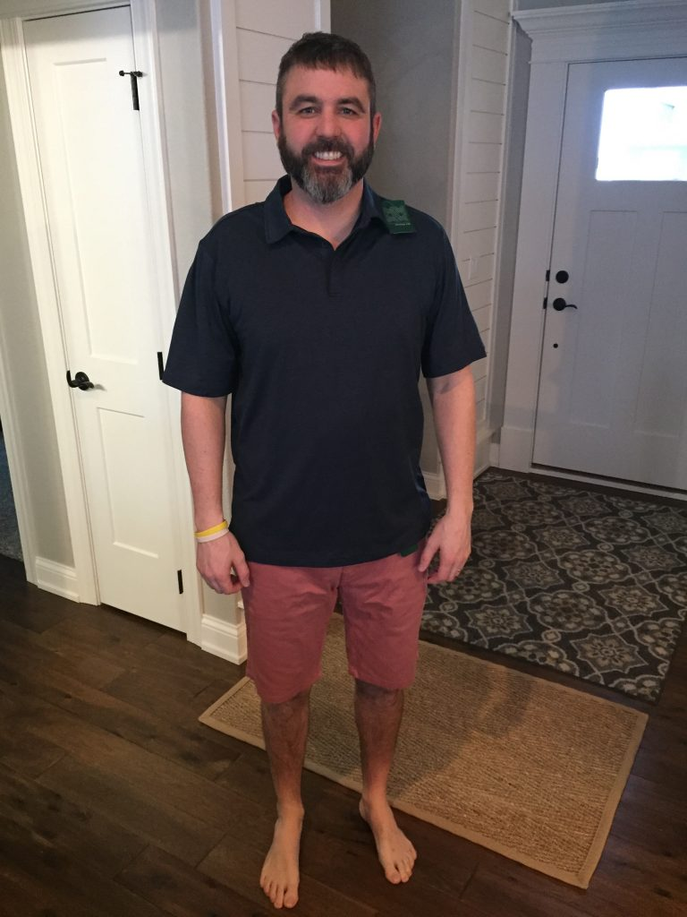 My husband trying on his Stitch Fix clothes. These were two of the items from his Stitchfix box.