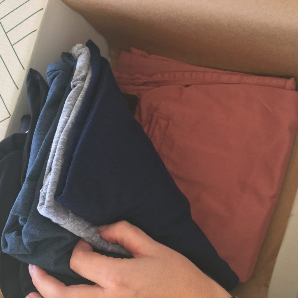 My Men's Stitch Fix Review with all of the clothes in the box. Showing the coral shorts.