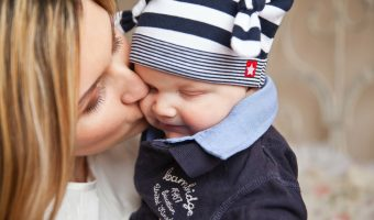 Mom kissing baby in free stuff for mms post