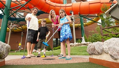 Family playing mini golf at the Traverse City location