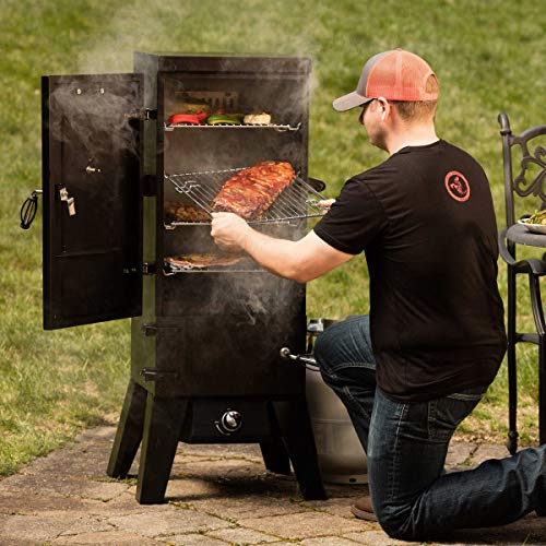 Man at a cuisinart smoker getting food out