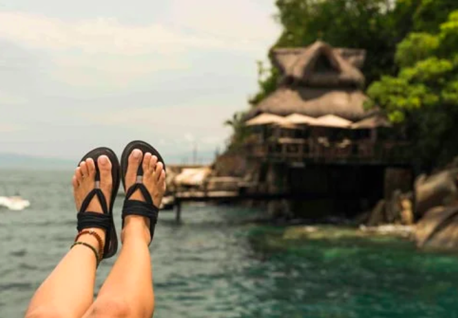 sanuk sandals over the water