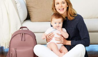 mom with baby and diaper bag backpack