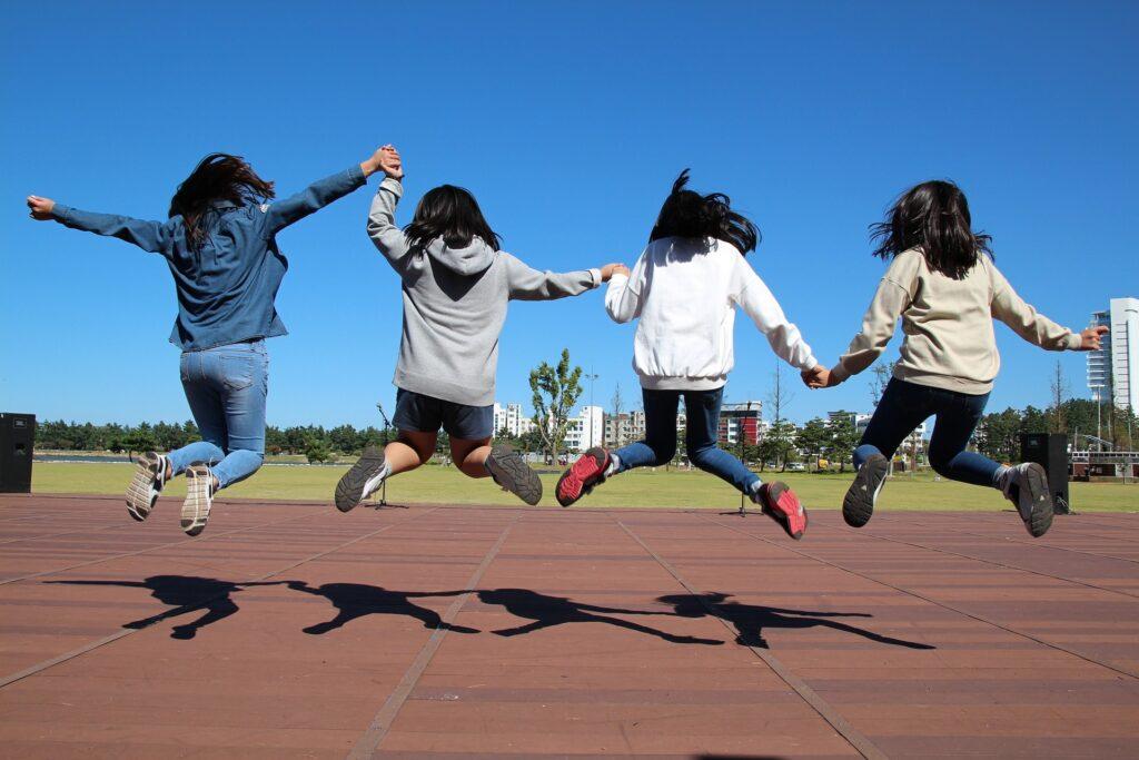 four girls having fun together