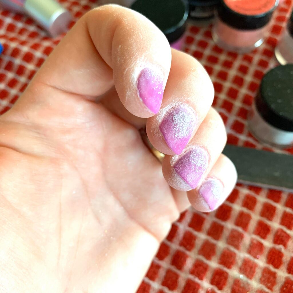 making dip nails smooth on top with nail block