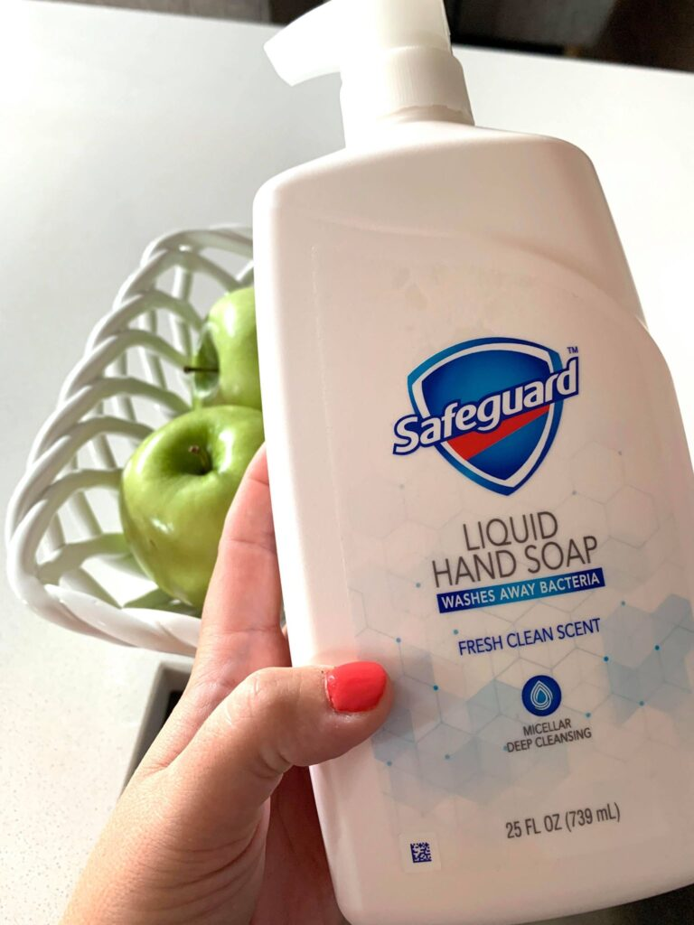 woman holding safeguard brand hand soap