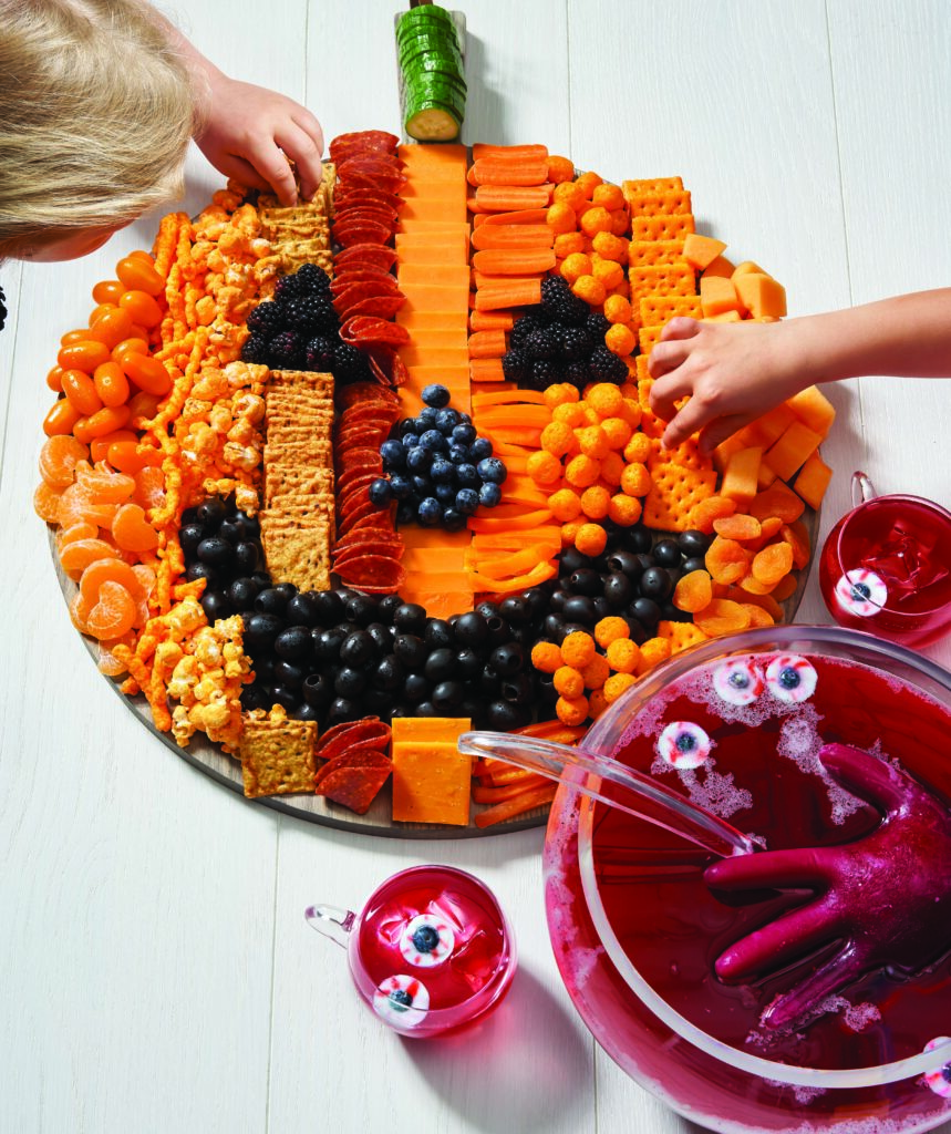 Jack o Lantern party try with cheese, vegetables and crackers